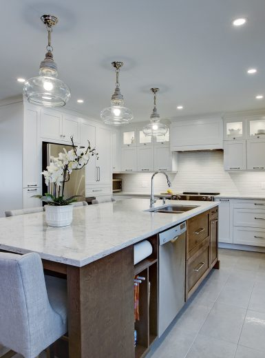 classic, elegant kitchen, glass cabinets, marble counters, marble backsplash, glass pendants (1)