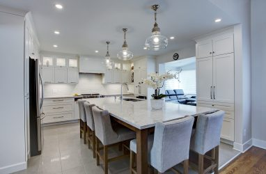classic, elegant kitchen, glass cabinets, marble counters, marble backsplash, glass pendants