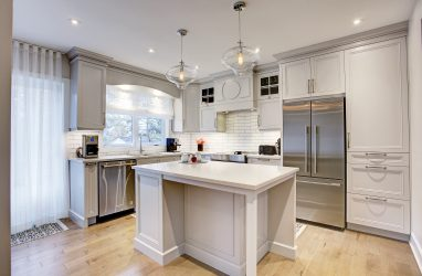 classic kitchen, grey cabinets, glass pendants, caesarstone counters,