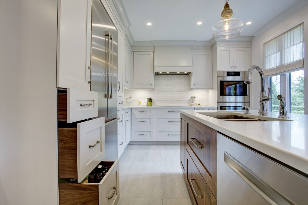 classic kitchen, white cabinets, walnut cabinets, glass pendants, caesarstone counters, island (1)