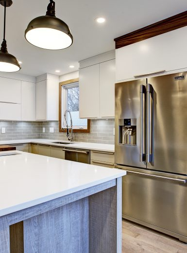 contemporary kitchen, quartz counters, island stools, walnut finishes, black pendants