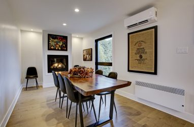 coontemporary dining room, wood table, fireplace