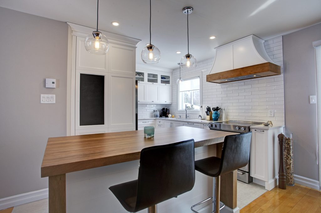 farmhouse kitchen, caesarstone counters, chalboard in kitchen, island, stools, glass pendants, butcher block, subway tiles,