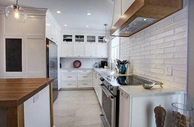 farmhouse kitchen, caesarstone counters, chalboard in kitchen, island, stools, glass pendants, butcher block, subway tiles, (1)