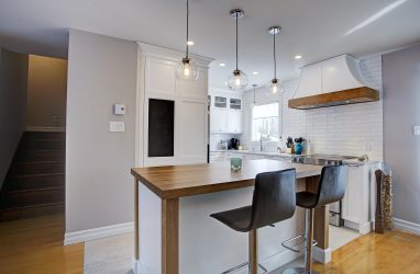 farmhouse kitchen, farmhouse sink, pattern on floor, subway tiles, caesarstone counters, island, stools, glass pendants, (1)