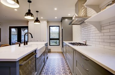 farmhouse kitchen, farmhouse sink, subway tiles, caesarstone counters, island, stools, metal pendants, butcher block, pattern floor