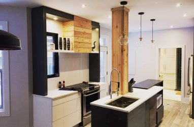 stone wall, kitchen, industiral kitchen, caesarstone counters, black counters, island, stools, glass pendants, , subway tiles, brick tiles